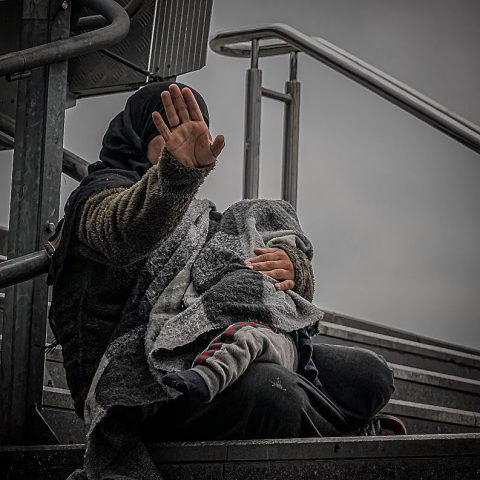 Syrian beggar with a baby in her arms